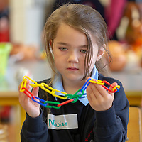 Naoise Beszant Queally makes a chain on her First day at school at Scoil Na Mainistreach Quin Dangan