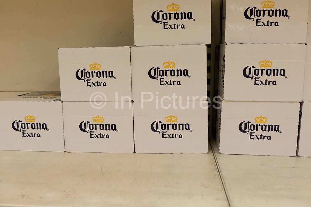 As the UK government announces further Coronavirus-related restrictions to its citizens, with the immediate closure of pubs, cafes, gyms and cinemas, and the worldwide number of deaths reaching 10,000 with 240,000 cases, 953 of those in London alone, only Corona is the only beers still on shelves at a Sainsburys supermarket in East Dulwich, on 20th March 2020, in London, England.