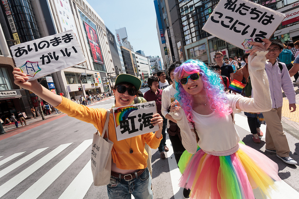 A gay couple at The Rainbow Pride Event in Shibuya, Tokyo, Japan. Sunday, April 26th 2015. This is the forth annual celebration of LGBT issues in Tokyo and forms part of a wider Rainbow Week. About 5% of the Japanese population identify as homosexual and this event hopes to foster a society where they can live equally and without prejudice.