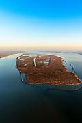 """Nederland, Zuid-Holland, Haringvliet, 07-02-2018; overzicht van het eiland Tiengemeten. Het eiland werd oorspronkelijk gebruikt voor de akkerbouw maar is inmiddels 'teruggegeven aan de natuur', de dijken zijn deels doorgestoken, de laatste boer is in 2006 vertrokken. De 'nieuwe natuur' vormt onderdeel van de Ecologische Hoofdstructuur.<br /> The island Tiengemeten in the Haringvliet, was originally used for agriculture but has now """"been given back to nature"""". Large parts have been flooded and the isle is part of the National Ecological Network. The last farmer left in 2006. Current use, among other, care farm and camping. <br /> luchtfoto (toeslag op standard tarieven);<br /> aerial photo (additional fee required);<br /> copyright foto/photo Siebe Swart"""