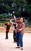01 DECEMBER 1988 - HONG KONG: People do Tai Chi exercises in Victoria Park in Hong Kong.   PHOTO © JACK KURTZ  women  health  lifestyle