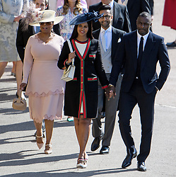 © Licensed to London News Pictures. 19/05/2018. London, UK. OPRAH WINFREY and Actor IDRIS ELBA and partner. Guests arrive at The wedding of Prince Harry, The Duke of Sussex to Meghan Markle, The Duchess of Sussex, at St George's Chapel in Windsor. Photo credit: Ben Cawthra/LNP