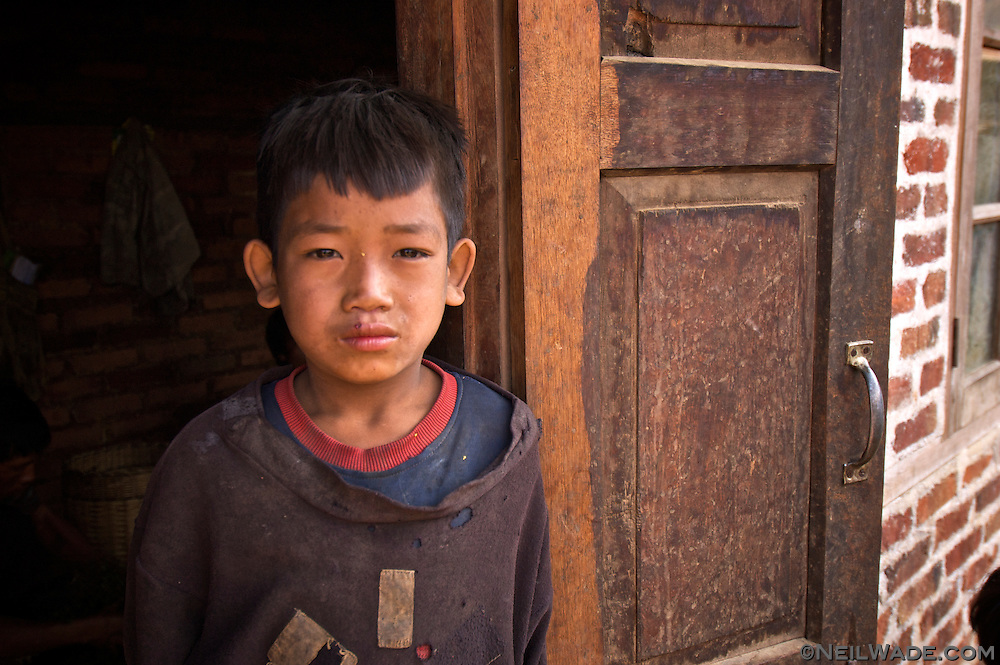 A young boy in a remote Burmese village.