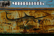 Sicily, Porto Palodi, Menfi, A paint on an abandoned boat used to transport immigrants from African continent to Sicily
