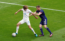 Czech Republic's Alex Kral (left) and Scotland's Stephen O'Donnell battle for the ball during the UEFA Euro 2020 Group D match at Hampden Park, Glasgow. Picture date: Monday June 14, 2021.