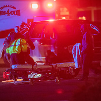 Gallup Police and emergency responders tend to a victim at the west side Conoco in Gallup Saturday.<br /> <br /> *** Caption is going to be pretty generic.  I could not figure out what the sequence of events was at the scene. ***
