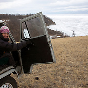 Heleen rides in a van on Olkhon Island towards Kuzhir after trekking across frozen Lake Baikal in Siberia, Russia. (third day)..They are a group of five people: Justin Jin (Chinese-British), Heleen van Geest (Dutch), Nastya and Misha Martynov (Russian) and their Russian guide Arkady. .They pulled their sledges 80 km across the world's deepest lake, taking a break on Olkhon Island. They slept two nights on the ice in -15c. .Baikal, the world's largest lake by volume, contains one-fifth of the earth's fresh water and plunges to a depth of 1,637 metres..The lake is frozen from November to April, allowing people to cross by cars and lorries.