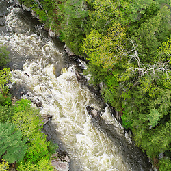 An aerial view of the Presumpscot River in Portland, Maine. Spring. Presumpscot Falls.