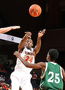 Nov. 15, 2010; Charlottesville, VA, USA; Virginia Cavaliers guard K.T. Harrell (24) passes the ball over USC Upstate Spartans guard Tony Dukes (25) during the game at the John Paul Jones Arena. Virginia won 74-54. Mandatory Credit: Andrew Shurtleff