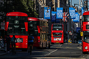 Red buses drive through Oxford Circus Street as a set of messages of love for the National Health Service (NHS) are hanged on the above of the main street near Oxford Street in London on Thursday, May 28, 2020. The government in Britain eased restrictions across England as a slow loosening of the coronavirus lockdown gets underway, with people now encouraged to return to work if unable to do so from home and unlimited outdoor exercise now allowed. As the row over Prime Minister Boris Johnson's top aide Dominic Cummings' Durham trip, continues, the prime minister's populist appeal has been hammered by the news and members of the public that, as the coronavirus outbreak raged, chief adviser Cummings drove 250 miles (400 kilometres) to his parents' house while he was falling ill with suspected COVID-19 allegedly flouting lockdown rules that the government had imposed on the rest of the country. (Photo/ Vudi Xhymshiti)