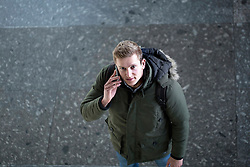 High angle view of a young man talking on a mobile phone, Freiburg im Breisgau, Baden-Wuerttemberg, Germany