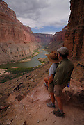 Tourists at the Nankoweap viewpoint  admiring the scenery, seen while rafting down the Colorado river Grand Canyon, Arizona, USA