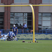 Kicking team Steve Weatherford (left), Zac DeOssie, (centre) and Josh Brown, practicing kicking timing during the 2013 New York Giants Training Camp at the Quest Diagnostics Training Centre, East Rutherford, New Jersey, USA. 29th July 2013. Photo Tim Clayton.