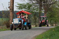 CZECH REPUBLIC VYSOCINA NEDVEZI 9MAY15 - A convoy of home-built tractors from Korouhev arrives at the tractor festival 'Traktoriada' in the village of Nedvezi, Vysocina, Czech Republic. Turnout was surprisingly large with over 100 tractors and hundreds of spectators to this event, held for the second time.<br /> <br /> jre/Photo by Jiri Rezac<br /> <br /> © Jiri Rezac 2015