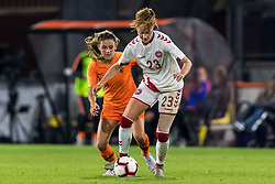 (L-R) Danielle van de Donk of Netherlands women, Karen Holmgaard of Denmark women during the FIFA Women's World Cup 2019 play off first leg qualifying match between The Netherlands and Denmark at the Rat Verlegh stadium on October 05, 2018 in Breda, The Netherlands