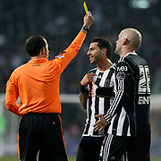 Referee's Cuneyt CAKIR (L) show the yellow card to Besiktas's Ricardo QUARESMA (C) during their Turkish Superleague Derby match Besiktas between Fenerbahce at the Inonu Stadium at Dolmabahce in Istanbul Turkey on Sunday, 20 February 2011. Photo by TURKPIX