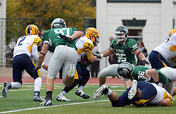 18 October 2014:  Benjamin Hodges encounters Brady Hails during an NCAA division 3 football game between the Augustana Vikings and the Illinois Wesleyan Titans in Tucci Stadium on Wilder Field, Bloomington IL