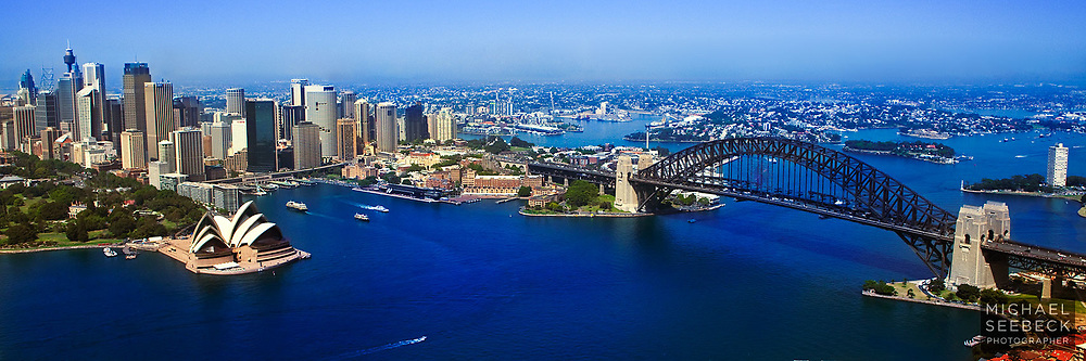 A panoramic view of Sydney Harbourm featuring the Sydney Harbour Bridge, and Sydney Opera House, taken from a helicopter, on a Spring day.<br /> <br /> Open Edition Print / Stock Image