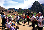 PERU, PREHISPANIC, INCA Machu Picchu; tour group and guide