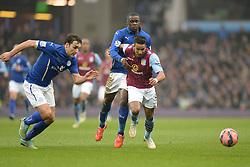 Leicester City's Jeffrey Schlupp hold back Aston Villas Scott Sinclair - Photo mandatory by-line: Alex James/JMP - Mobile: 07966 386802 - 15/02/2015 - SPORT - Football - Birmingham - Villa Park - Aston Villa v Leicester City - FA Cup - Fifth Round