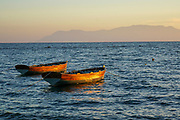 Small fishing boats anchored off shore in the Aegean Sea, Greece
