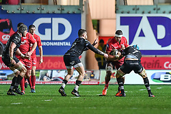 Scarlets' Aaron Shingler is tackled by Ospreys' Rhys Webb and Justin Tipuric - Mandatory by-line: Craig Thomas/Replay images - 26/12/2017 - RUGBY - Parc y Scarlets - Llanelli, Wales - Scarlets v Ospreys - Guinness Pro 14