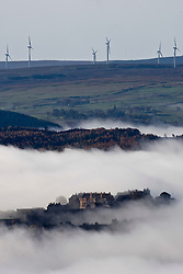 Stirling Castle seen through morning mist. The castle stands on the summit of Castle Hill and is one of the largest and most important castles, both historically and architecturally, in Scotland. At the top of the image can be seen the turbines for the Earlsburn wind farm..Pic ©2010 Michael Schofield. All Rights Reserved.