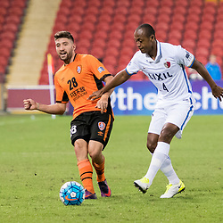 BRISBANE, AUSTRALIA - APRIL 12: Brandon Borrello of the Roar passes the ball under pressure from Hugo Leonardo Serejo of Kashima during the Asian Champions League Group Stage match between the Brisbane Roar and Kashima Antlers at Suncorp Stadium on April 12, 2017 in Brisbane, Australia. (Photo by Patrick Kearney/Brisbane Roar)