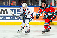 KELOWNA, BC - NOVEMBER 16: Jake Poole #23 of the Kelowna Rockets stick checks Caedan Bankier #14 of the Kamloops Blazers as he skates with the puck at Prospera Place on November 16, 2019 in Kelowna, Canada. (Photo by Marissa Baecker/Shoot the Breeze)