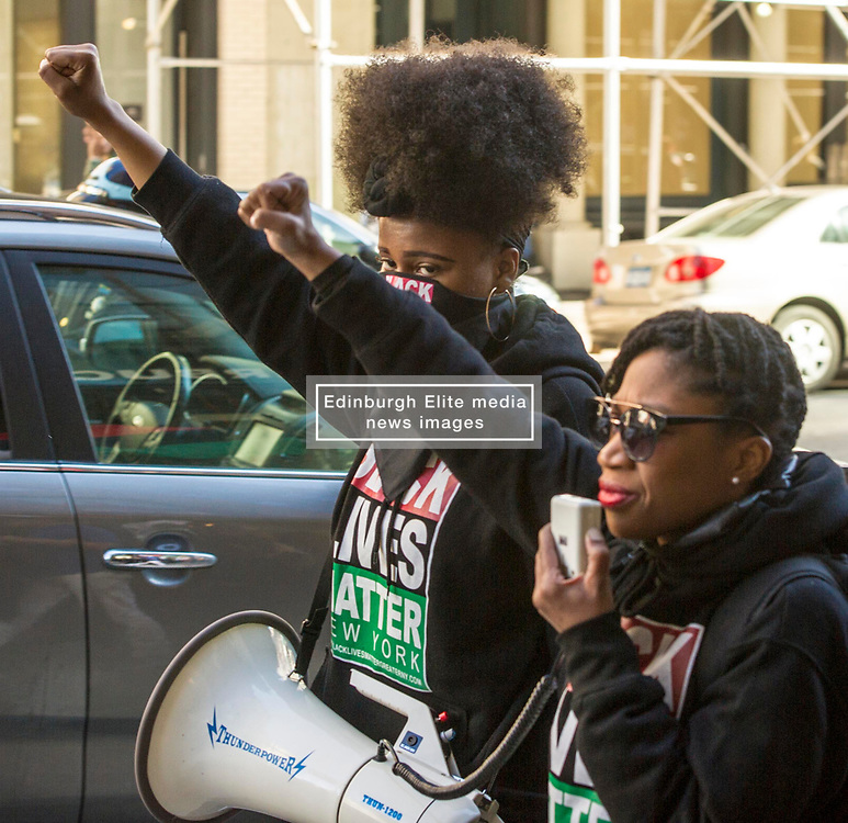 Pictured: <br /> Sunday saw the Black Lives Matter movement lead a protest march starting at the Battery and headed up Broadway in New York which revived the Black Violence, White Silence chant of the 60s. Around 150 protesters were accompanied by around 20 NYPD officers, some on motor cycles, to ensure nothing untoward happened on a very hot New York Sunday<br /> <br /> <br /> Ger Harley   EEm 9 April; 2017