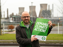 Grangemouth, Scotland, UK. 7th December 2019. Scottish Greens co-leader Patrick Harvie joined Linlithgow and East Falkirk candidate Gillian Mackay for a demonstration outside INEOS offices in Grangemouth. The refinery operated there by INEOS is Scotland's biggest polluter according to the Greens. The Scottish Greens are calling for the end of shale gas imports, which bring fracked gas from the US to Grangemouth. Pictured; Patrick Harvie.<br /> Iain Masterton/Alamy Live News