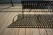 Shadow of a bench on the boardwalk