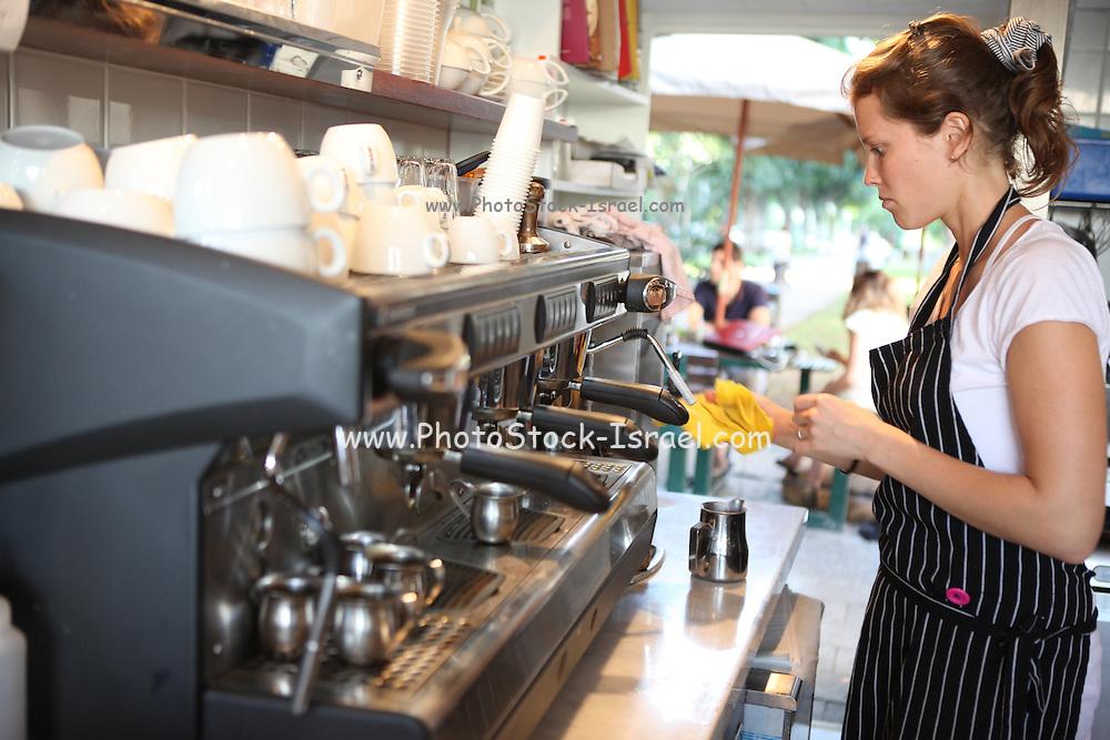 Female barista makes espresso coffee