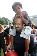 Jeffery Wright with his son, Elishah Wright at the Spike Lee's Brooklyn celebration for Michael Jackson's Birthday held at the Neader field in Prospect Park, Brooklyn on August 29, 2009..Filmmaker Spike Lee celebrates the ' King of Pop ' Birthday with a crowd packed party remembering the recently departing All time Great with a day long spinning of his music in Brooklyn's own Prospect Park