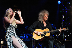 """© Licensed to London News Pictures. 16/09/2012. London, UK.  Kerry Ellis (L) and Brian May (Right)  perform at The Sunflower Jam at the Royal Albert Hall.  The Sunflower Jam is a British charity, founded by Jacky Paice, wife of Deep Purple drummer, Ian Paice. Other high-profile supporters are the actor Jeremy Irons, ex-Jamiroquai bassist Nick Fyffe and Charles, Prince of Wales. The aims of the charity are to fund complementary therapists and spiritual healers to work on cancer wards in the British National Health Service. After setting up a meeting between members of Deep Purple and a young boy dying of leukemia, Paice saw """"all the good work the healers were doing"""" and decided """"lets find a way to raise money to get more healers in there. Brian May is a founding member and guitarist of Queen, Kerry Ellis is a lead singer in West End Musicals and played the role of 'Meat' in Queen's We Will Rock You  Photo credit : Richard Isaac/LNP"""