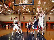 Middletown, N.Y. - Kola Drejaj, right, of Orange County Community College takes a shot during a men's basketball game against Queensborough Community College on Feb. 4, 2006. ©Tom Bushey