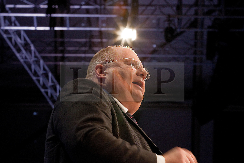 © Licensed to London News Pictures. 03/10/2011. Manchester, UK. The Secretary of State for Communities and Local Government, Eric Pickles, addresses the audience at the Conservative Party Conference in Manchester. Photo credit : Joel Goodman/LNP