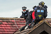 """Tamworth, United Kingdom, July 12, 2021: Police Protest removal Unit arrested two activists from the """"Palestine Action"""" activist group who scaled the roof, daubed blood-red paint and smashed the windows across the Elite KL site on Amington Industrial Estate in Tamworth early on Monday, July 12, 2021. Activists said that the brand is part of the Elbit company, which describes itself as a """"multi-domestic defence and electronics supplier"""". (VX Photo/ Vudi Xhymshiti)"""