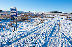 © Licensed to London News Pictures. 18/01/2015. A small road on the high moorland of the Mynydd Epynt 400 metres above sea levelMid Wales woke to sub zero temperatures and a beautiful blue sky. Mynydd Epynt, Powys , Wales, UK. Photo credit: Graham M. Lawrence/LNP