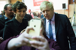 """© Licensed to London News Pictures . 15/04/2016 . Manchester , UK . A member of the audience reaches forward for a selfie with BORIS JOHNSON after he speaks at a """" Vote Leave """" rally at Old Granada Studios , in Manchester . Photo credit: Joel Goodman/LNP"""