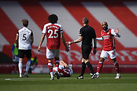 Football - 2020 /2021 Premier League - Arsenal v Fulham - Emirate Stadium<br /> <br /> Arsenal's Alexandre Lacazette protests to Referee Craig Pawson after a challenge on Granit Xhaka.<br /> <br /> COLORSPORT