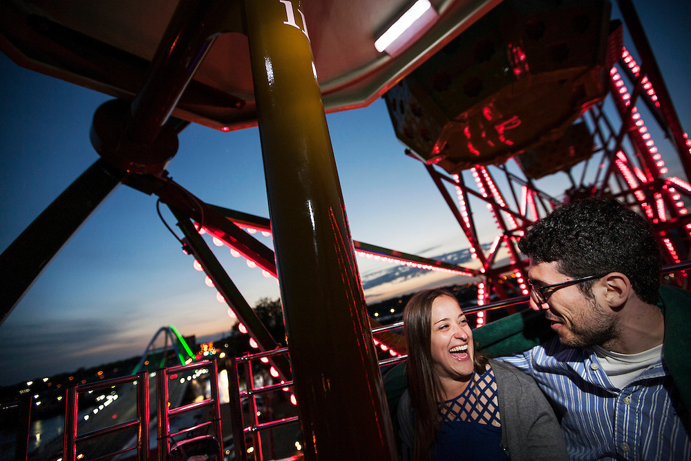 Meg Blickendorf, left, and Zack Rosen ride the vertically revolving patio (Ferris wheel) during a date night celebrating Meg's birthday at Betty Danger's Country Club in Minneapolis May 9, 2015.   (Courtney Perry)