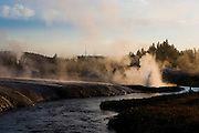 The Little Firehole River winds through a geyser basin at sunrise in Yellowstone National Park, Wyoming.