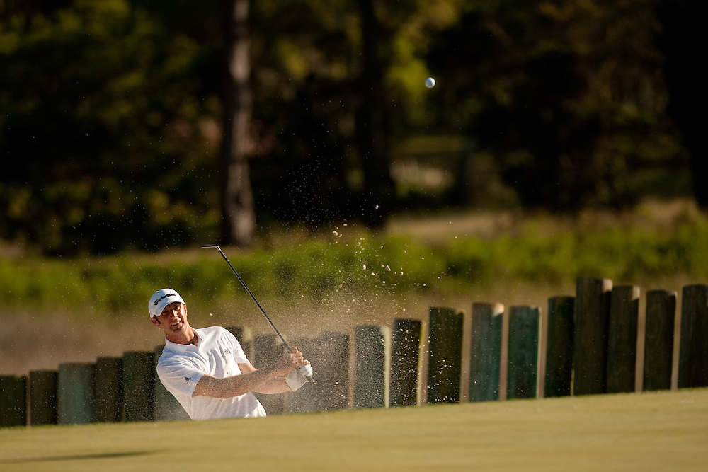 HILTON HEAD, SC - APRIL 17:  Dustin Johnson hits his bunker shot during the second round of the 2009 Verizon Heritage in Hilton Head, South Carolina at Harbour Town Golf Links on Friday, April 17, 2009. (Photograph by Darren Carroll) *** Local Caption *** Dustin Johnson
