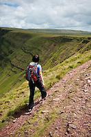 Female hiker on Bannu Sir Gaer ridge, Black Mountain, Brecon Beacons national park, Wales