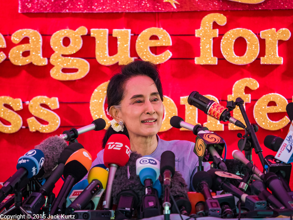 """05 NOVEMBER 2015 - YANGON, MYANMAR: AUNG SAN SUU KYI smiles during a press conference. During the press conference, which lasted 90 minutes, Aung San Suu Kyi, the leader of the National League for Democracy (NLD), said that if the NLD won the election she would serve """"above"""" the President. When questioned about the Rohingya crisis in western Myanmar, a reporter called the situation """"dramatic"""" and Suu Kyi replied the entire country is in a """"dramatic situation"""" and the problems of the Rohingya should not be """"exaggerated."""" She said the """"great majority of our people remain as poor as ever."""" She also said the NLD would make a """"fuss"""" if election results were """"suspicious."""" Citizens of Myanmar go to the polls Sunday November 8 in what is widely viewed as the most democratic and contested election in Myanmar's history. The NLD is widely expected to win the election.   PHOTO BY JACK KURTZ"""