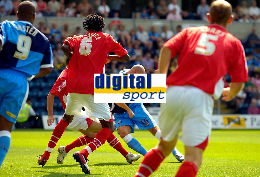 Photo: Alan Crowhurst.<br />Wycombe Wanderers v Wrexham. Coca Cola League 2.<br />05/08/2006. Wycombe's Tommy Mooney (C) scores the opener.