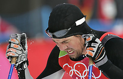 Feb. 21, 2006 - U.S. - Oliver Kraas of the Republic of South Africa shows the face of pain after he crosses the finish line of a qualification round in the men's cross country sprint at Pragelato Plan, Italy during the 2006 Winter Olympics Wednesday, February 22, 2006. (Gary Reyes/San Jose Mercury News/KRT) (Credit Image: © Gary Reyes/TNS/ZUMAPRESS.com)