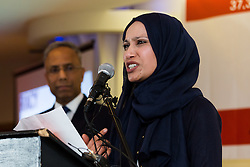 © Licensed to London News Pictures. 01/05/2015. London, UK. Councillor, Rabina Khan speaking as Ex Mayor of Tower Hamlets, Lutfur Rahman watches at a public meeting held at the Waterlily in Stepney, east London on 30th April 2015. The meeting was ex Mayor of Tower Hamlets, Lutfur Rahman's first public appearance after being found guilty of electoral fraud last week and called for attendees to donate money to a legal fund to facilitate an appeal against the High Court ruling. Photo credit : Vickie Flores/LNP