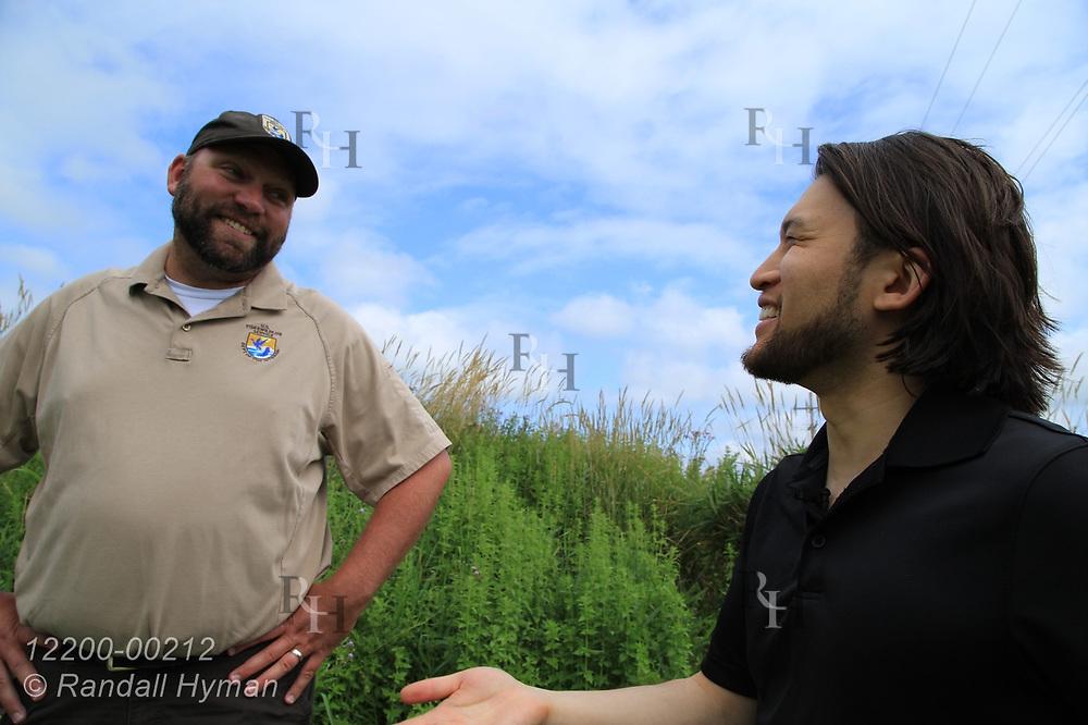 Refuge manager Eric Dunton talks with Hyfi CEO Brandon Wong during installation of water-level sensor in wetland at Shiawassee National Wildlife Refuge; Saginaw, Michigan.